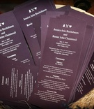 Ceremony programs in dark eggplant purple
