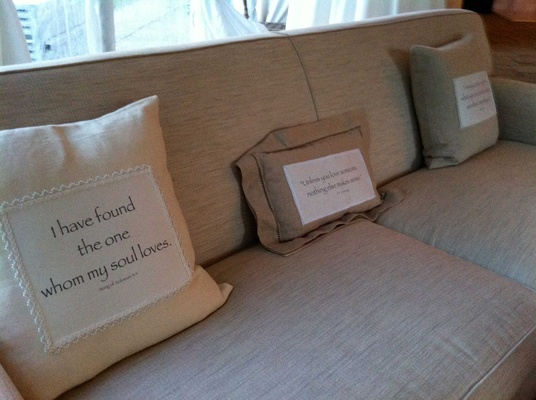 beige couch at reception with bible passages printed on pillows bible passages furniture