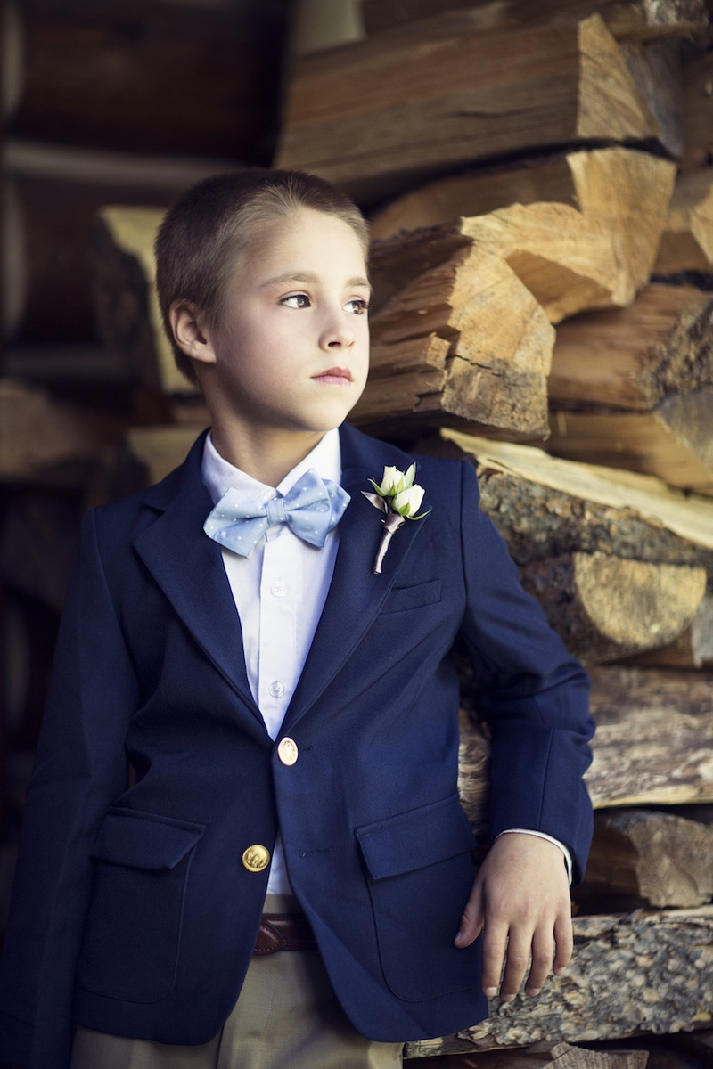 Little boy wearing casual suit with bow tie