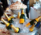 Bottles of Veuve Clicquot Champagne on ice at a wedding cocktail hour