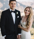 bride in strapless romona keveza wedding dress with sweetheart neckline, groom in hugo boss tuxedo