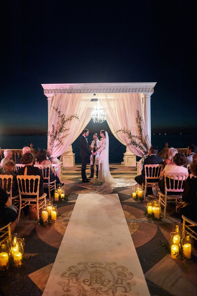 jewish ceremony after sunset with chandelier under chuppah for lighting