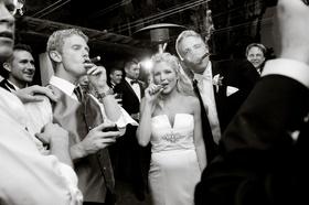 bride and groom relax at reception cigar bar at Four Seasons Biltmore, Santa Barbara