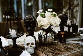 halloween wedding ideas wood table with mercury glass silver pumpkin centerpiece black white skulls
