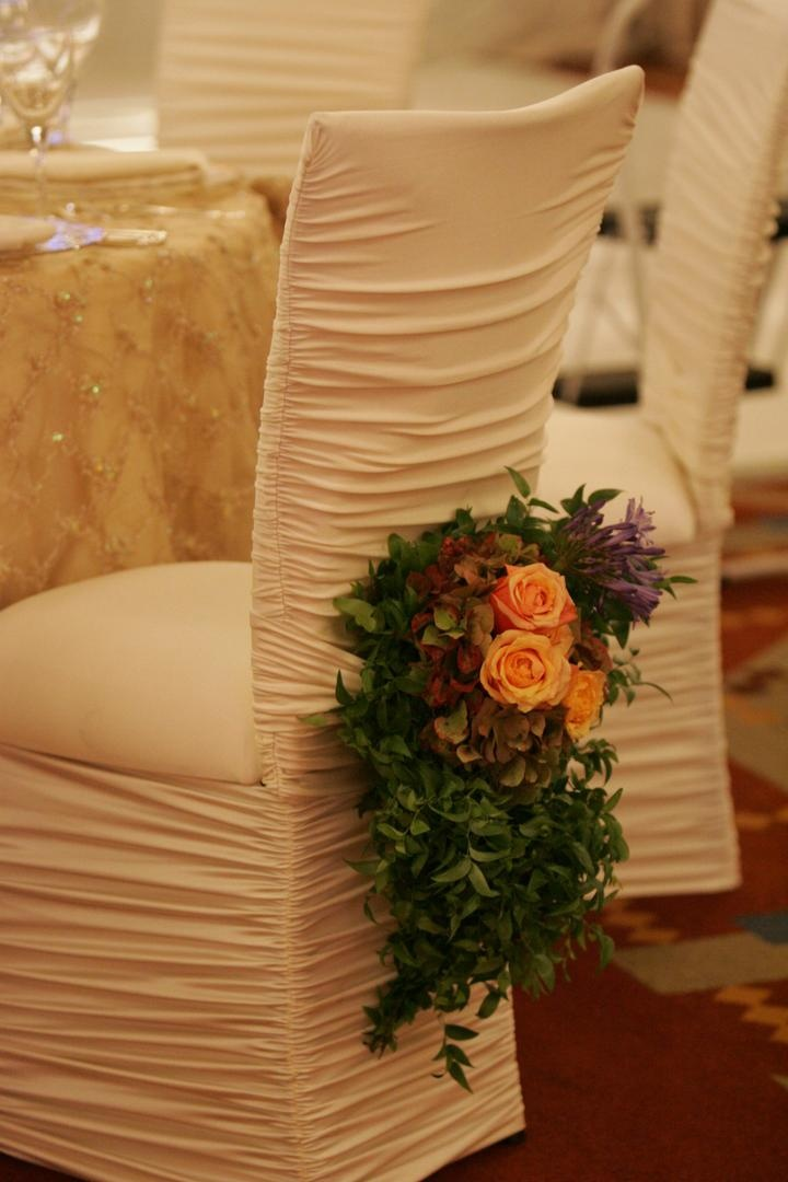Ruched ivory chair covers at reception