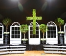 Magnolia cross and ficus trees on wedding stage