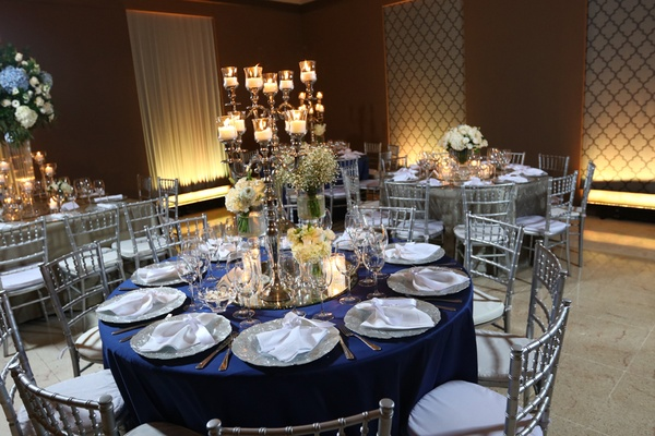 navy linen circular table gray details dominican republic wedding ballroom reception mirror candles