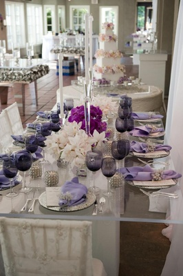 Wedding reception table with mirror and purple