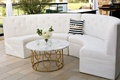Wedding reception patio lounge area white tufted settee black white stripe celebrate pillow marble