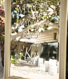 Wedding ceremony welcome sign on mirror frame easel at outdoor wedding santa monica fairmont bungalo