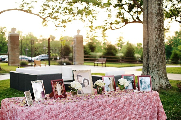 Pink rose linens on table with framed family photos