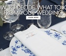 wedding reception table with blue floral china pattern, navy table runner and white linen