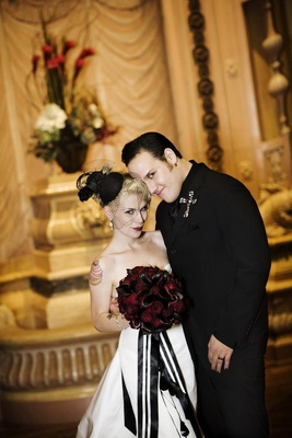 Brandon Saller, drummer of Atreyu, with bride in an Alvina Valenta dress and black wedge veil