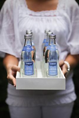Bottles of sparkling lemonade on white tray