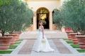 Bride standing between trees in strapless dress