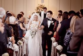 Keri Lynn Pratt and husband walk up church aisle