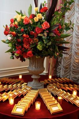 Escort card table flower arrangement in stone urn