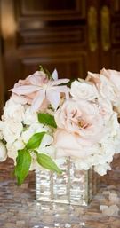 blush rose and ivory orchid flower arrangement in reflective base centerpieces for cocktail hour