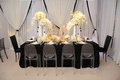 Elegant drapery and rectangular guest table