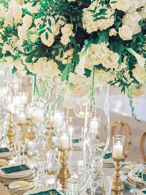 wedding reception long table white hydrangea rose greenery centerpiece crystals gold candleholders