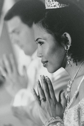 Black and white photo of bride praying
