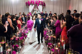 asian bride and groom wedding inspiration, fuchsia orchids, purple orchids, guests taking photos