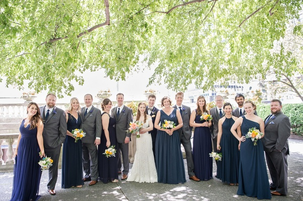 Wedding party blue bridesmaid dresses and groomsmen in grey suits blue ties bride romona keveza