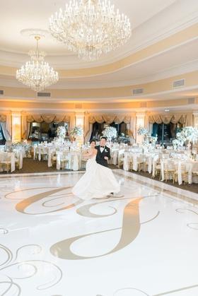 wedding reception oheka castle chandeliers white dance floor with gold monogram regal decor
