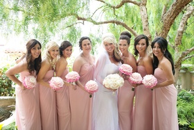 Bride in white ombre dress with pink bridesmaid dresses