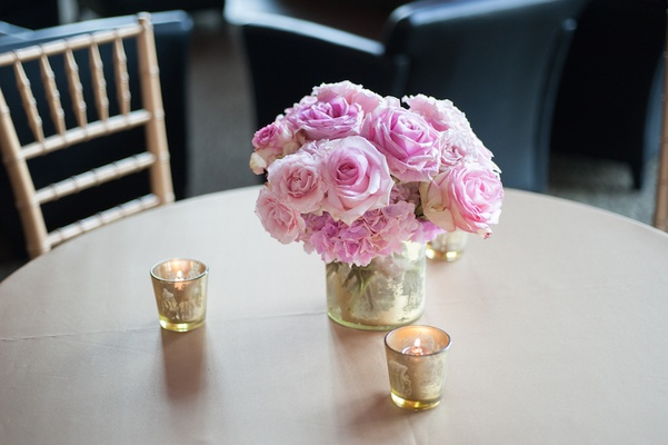 Mercury glass candles and low floral centerpiece