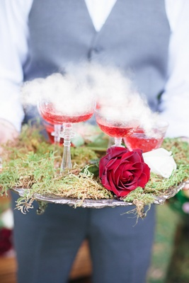 red cocktails featuring dry ice steam on platter moss celtic wedding