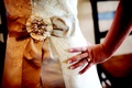 Vera Wang gown with bow sash with crystal and pearl center