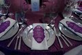 wedding reception, purple linens, silver chargers, silver napkins, purple menus