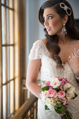 Bride with beaded vintage inspired wedding dress and side part hairstyle