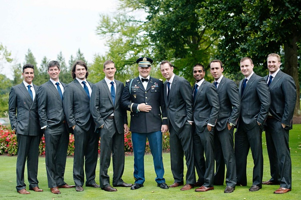 Groom in dress blues uniform and groomsmen with blue ties