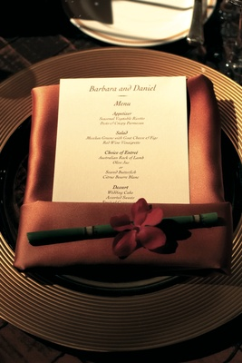 Fall inspired place setting with orange napkin