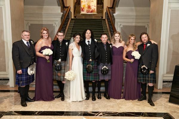 Bride in a Jenny Packham dress, bridesmaids in purple dresses, groom & groomsmen in kilts, blazers