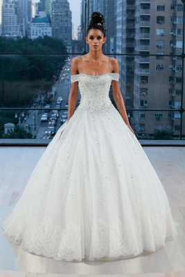 Embellished classic off the shoulder drop waist ball gown with accent lace hem border.
