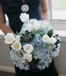 Navy blue bridesmaid dress with light blue flowers