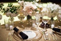 Wedding reception guest place setting decor black white circle menu gold charger plate low flowers