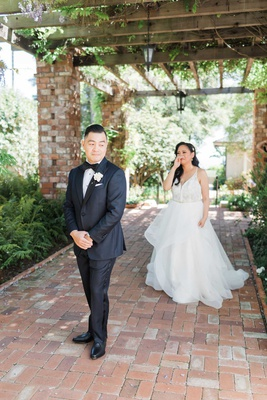 wedding in santa barbara terrace brick flooring first look bride crying holding up hand