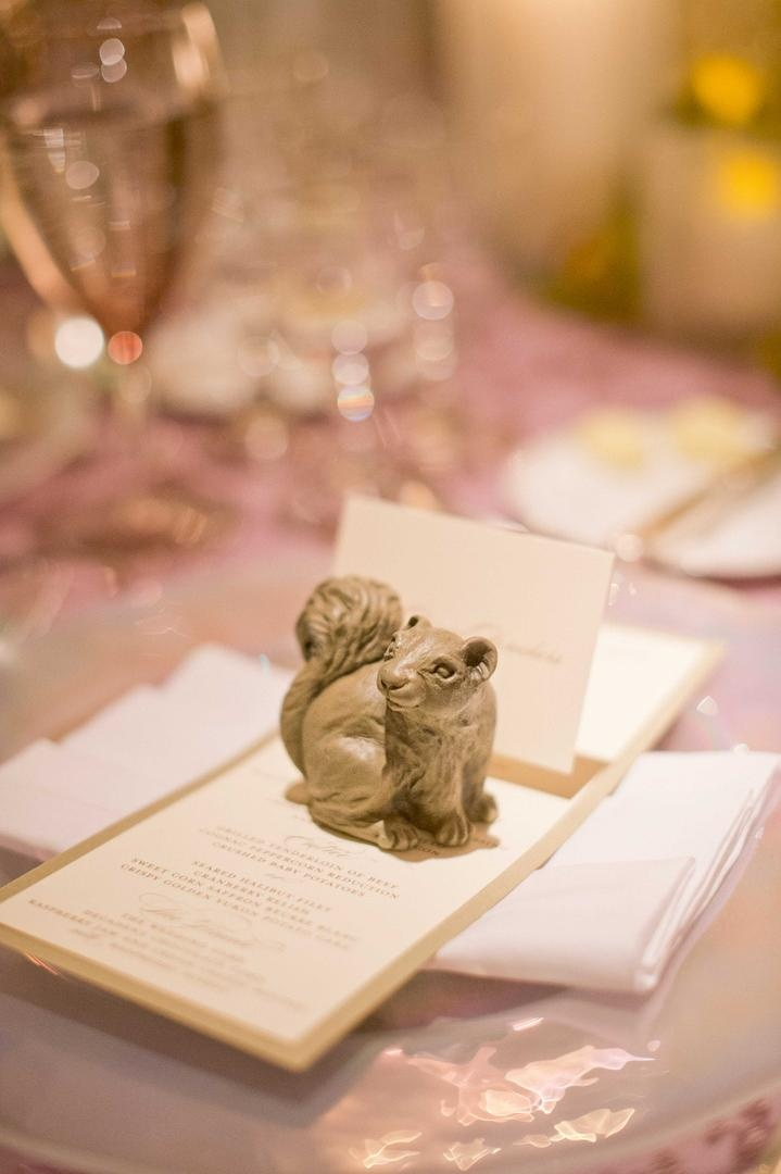 Table card holder in shape of squirrel at wedding