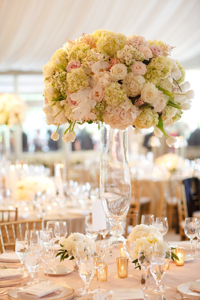 Wedding reception tall centerpiece of light green hydrangeas, pink roses, white orchids, peonies