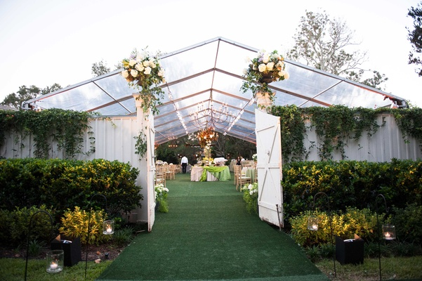 Clear tent with white fence at at home wedding for Father of the Bride theme