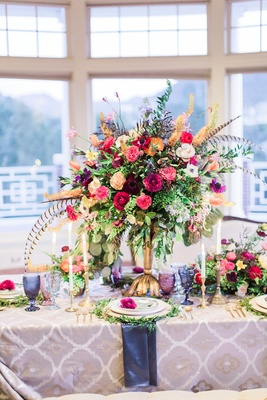 colorful flower arrangement with pheasant feathers