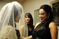 Bride with veil over face and bridesmaids