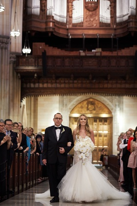 bride in galia lahav wedding dress trumpet gown orchid bouquet father processional church pews