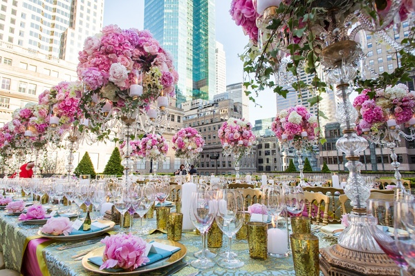 Real weddings bridal showers amp rehearsal dinners inside weddings gold votive candle holders amid tall candelabrum junglespirit Image collections