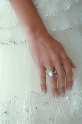 Bride's hand with sparkling halo wedding ring