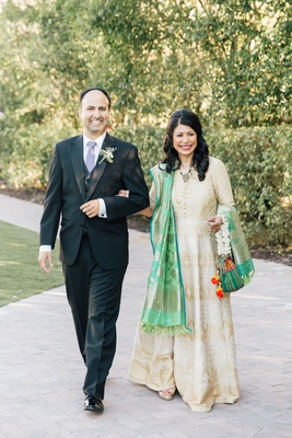wedding processional mother of bride in hindu traditional attire with colorful sash escorted